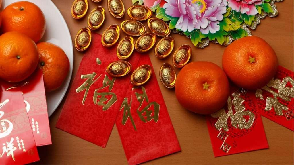 Red envelopes lay on table amid festive decorations for the Chinese New Year.