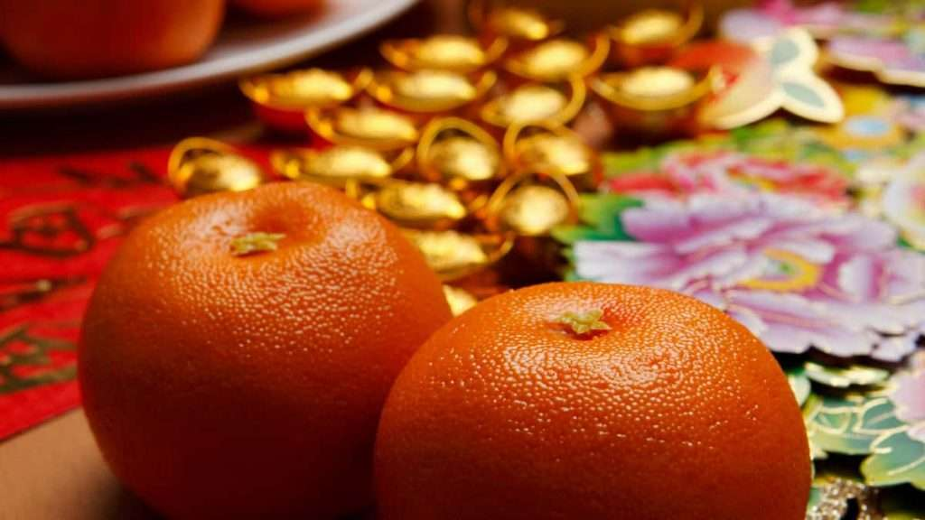 Oranges sit amid festive decorations for the Chinese New Year.